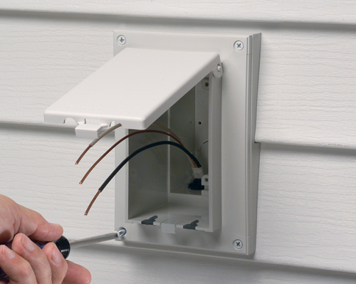 """Arlington's Low Profile In Box is excellent for retrofit siding construction. The single gang box replaces an electrical box, siding block, and bubble cover assembly with one unit. Mounts vertically to siding with a lap size of 1/2"""" and has a white cover."""