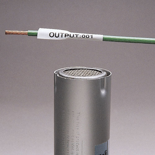 """The thermal transfer military grade heat-shrink label in white is single sided with a 3/8"""" (9.525mm) diameter and made of 3:1 flattened polyolefin. It is 1"""" (25.4mm) wide and .64"""" (16.3mm) high. The heat-shrink sleeve is designed to provide a clear, relia"""